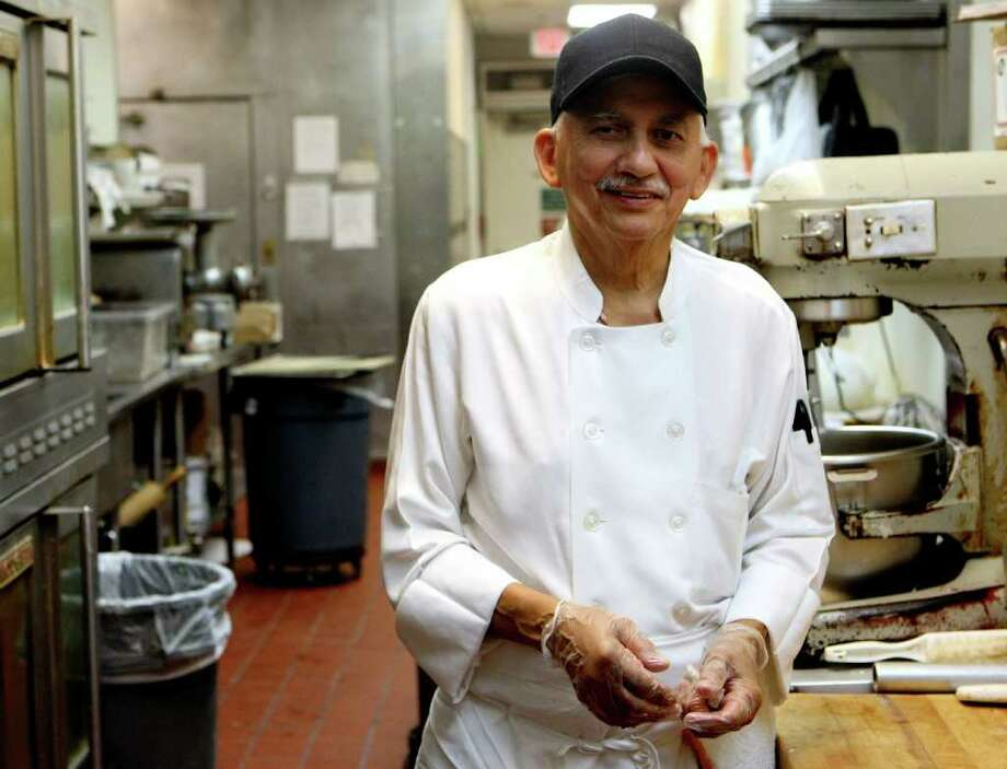 Tony Sanchez, head baker at Earl Abel's, celebrated his 50th year with the restaurant in December.  He started at the restaurant as a bus boy in his teens. Photo: HELEN L. MONTOYA, HELEN L. MONTOYA/hmontoya@conexionsa.com / hmontoya@express-news.net
