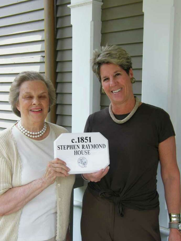 Marian Castell, town historian, presents the Darien Historical society Historic House Plaque to homeowner Lynn Hamlen. The plaque recognizes that the c.1851 Stephen Raymond House at 7 Davis Lane is of historical importance to the Town of Darien. Photo: Contributed Photo / Darien News