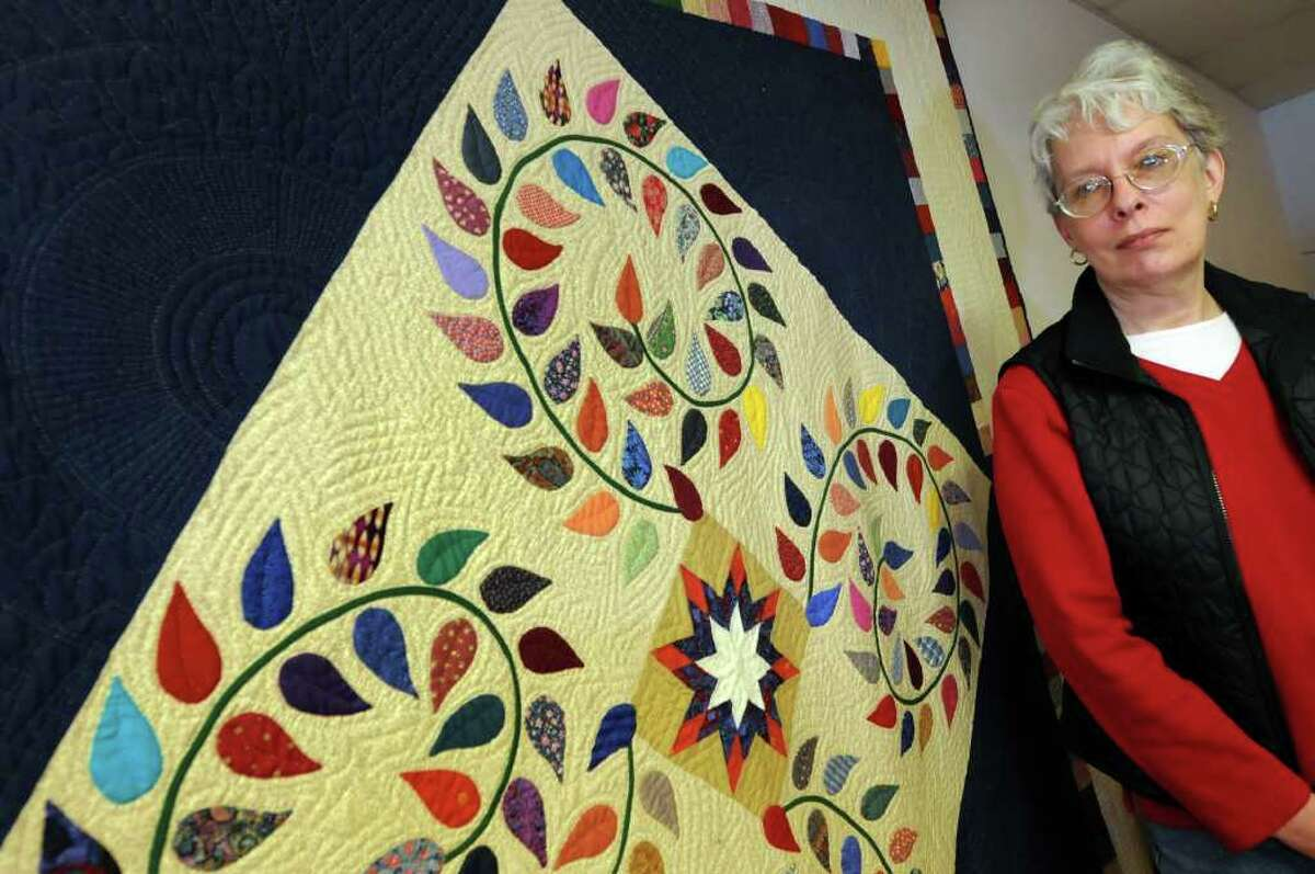 Quilter Janet Atkins of Coxsackie stands by one of her hand-sewn quilts on Wednesday, March 16, 2011, in Coxsackie, N.Y. An award-winning quilt, that was mailed through UPS, is missing(Cindy Schultz / Times Union)