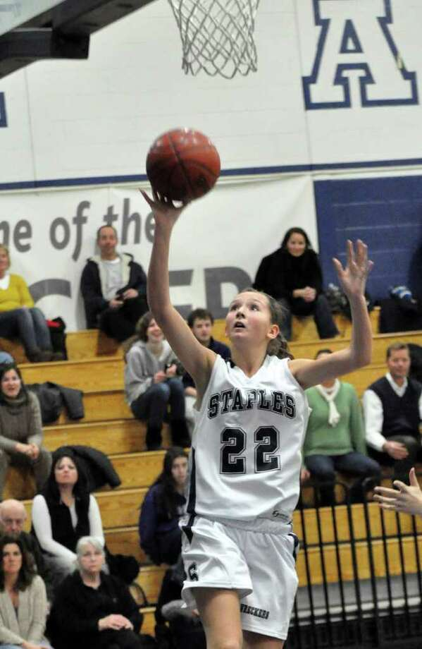 Staples' Nikki Bukovsky (22) goes up for a shot during the girls basketball game against Fairfield Warde at Staples on Monday, Jan. 10, 2011. Photo: Amy Mortensen, ST / Connecticut Post Freelance