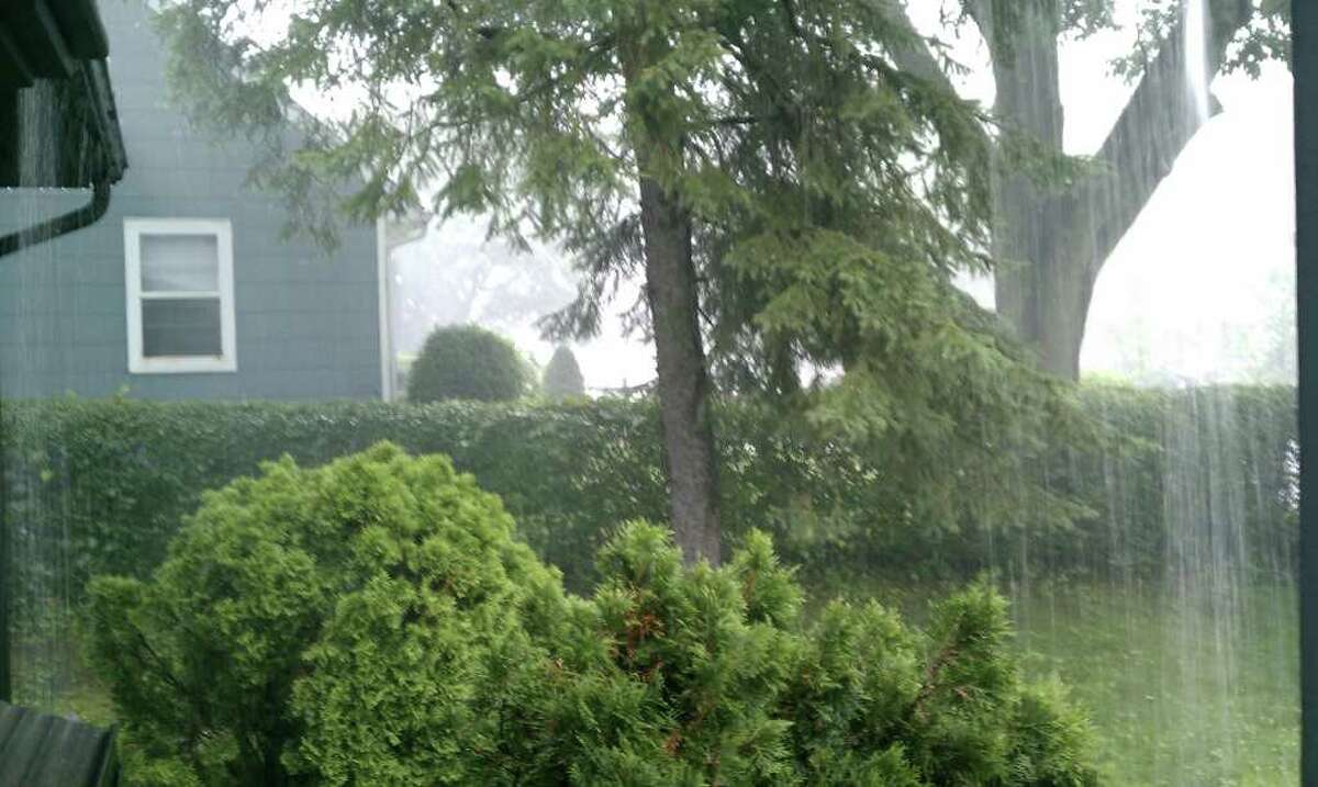 Heavy rain falls in Norwalk, Conn. on Thursday, June 23, 2011.