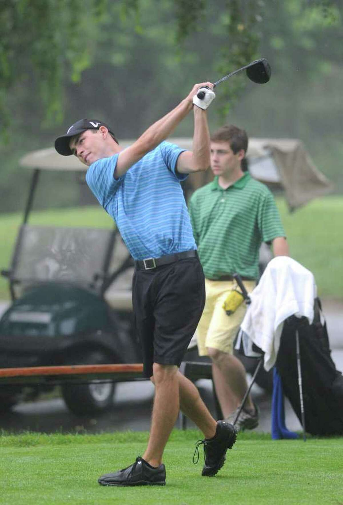 Greg Reilly drives off the first tee during quarterfinal match play at the 109th Connecticut Amateur Golf Championship, Rolling Hills Country Club, Wilton, Conn., Thursday morning, June 23, 2011..