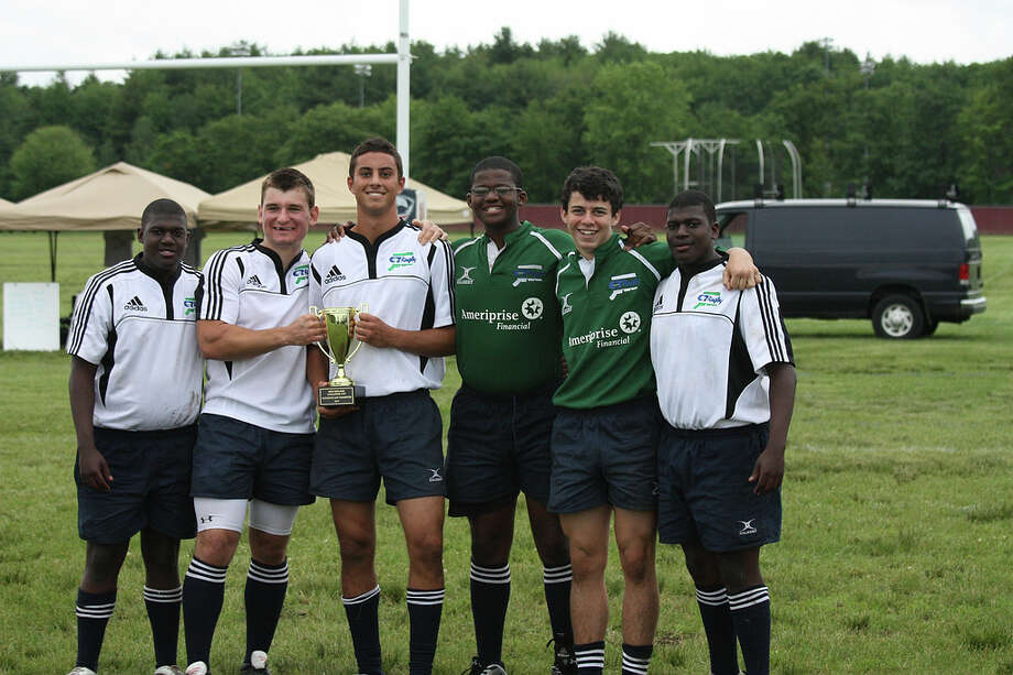 Staples rugby players, from left, Adam Washington, Yuri Lenskiy, Bret Epright, Mikell Washington, Matt Cozzi and Andrew Washington helped the Connecticut All-Star team win the New England All-Star championships. Photo: Contributed Photo