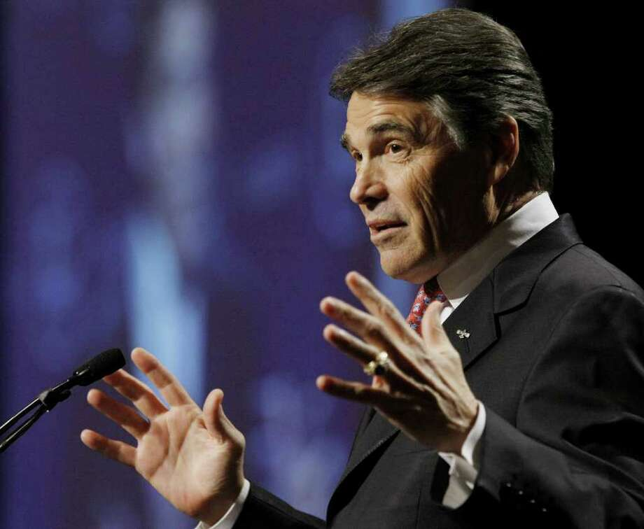 Texas Gov. Rick Perry speaks during the 28th annual National Association of Latino Elected and Appointed Officials conference, Thursday, June 23, 2011, in San Antonio. Photo: Express-News