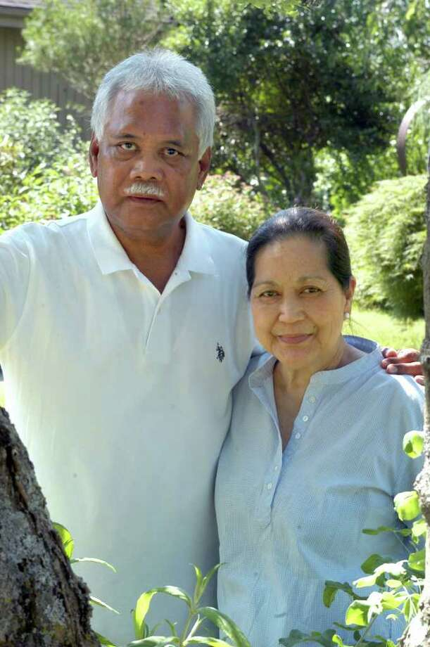 Efren and Anita Rebong's oldest son, Mark, was murdered while driving to work from Newtown on Interstate 84 in 2000. The case remains unsolved. Photo: John Pirro / The News-Times