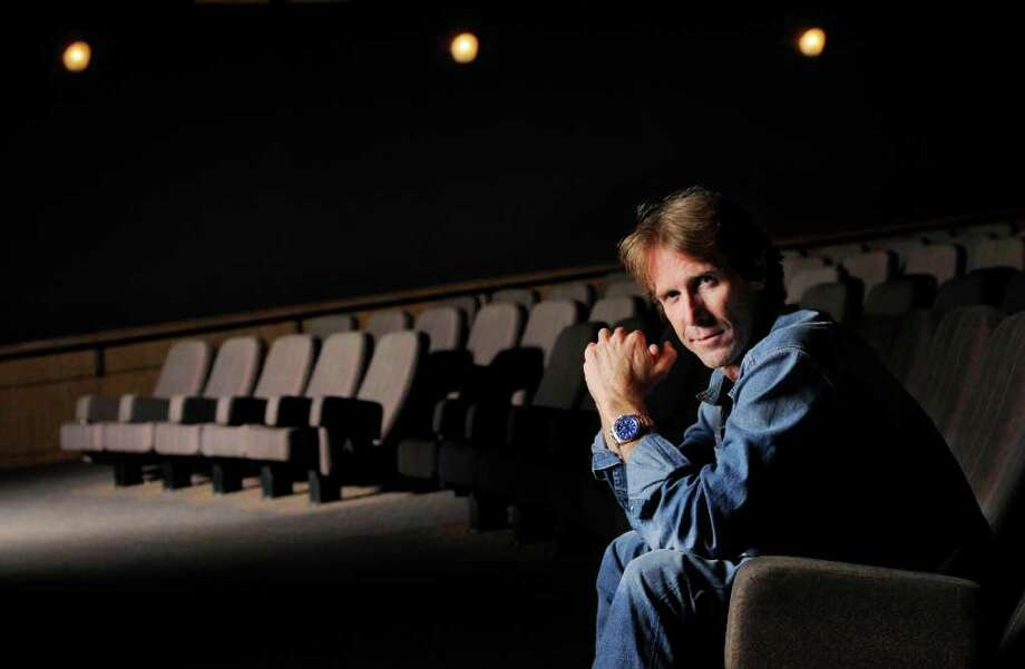 "In this June 15, 2011 photo, filmmaker Michael Bay poses for a portrait at Paramount Theatre in Los Angeles. Bay directed the upcoming film, ""Transformers: Dark of the Moon.""  (AP Photo/Chris Pizzello) Photo: Chris Pizzello"