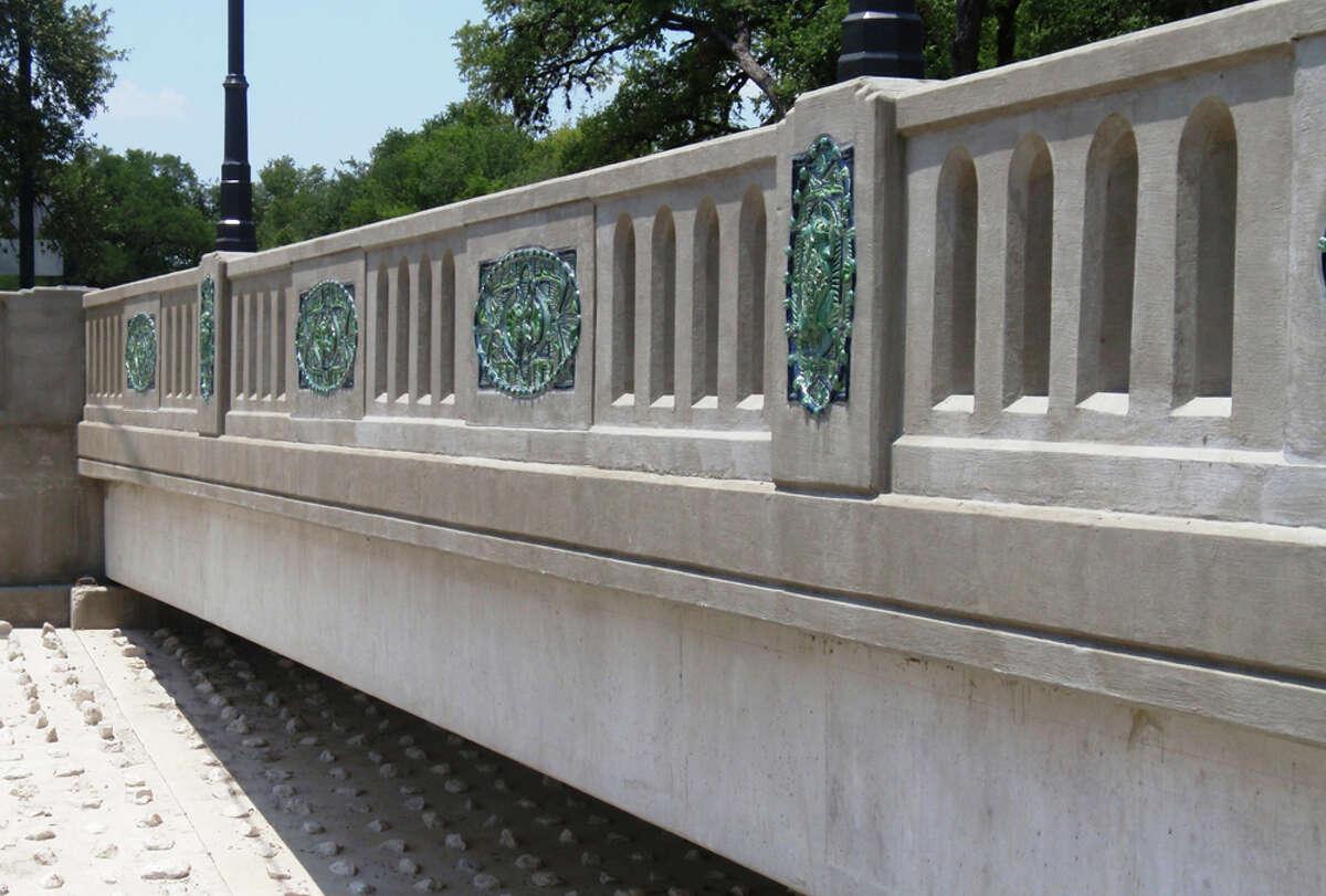 San Antonio ceramic artist Diane Kersey's toad motif panels adorn the new Mulberry Avenue bridge. STEVE BENNETT / EXPRESS-NEWS
