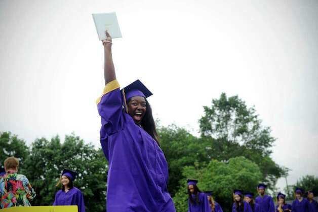 Jazzmin Thomas and her diploma as Westhill High School's class of 2011 commencement exercises in Stamford, Conn., June 23, 2011. Photo: Keelin Daly / Stamford Advocate