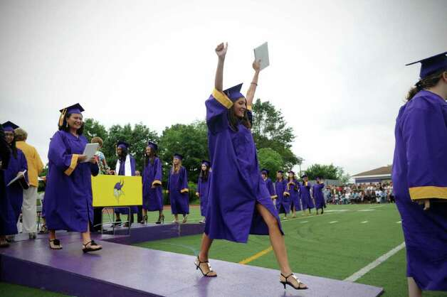 Victoria Gau celebrates after receiving her diploma during the Westhill High School's class of 2011 commencement exercises in Stamford, Conn., June 23, 2011. Photo: Keelin Daly / Stamford Advocate