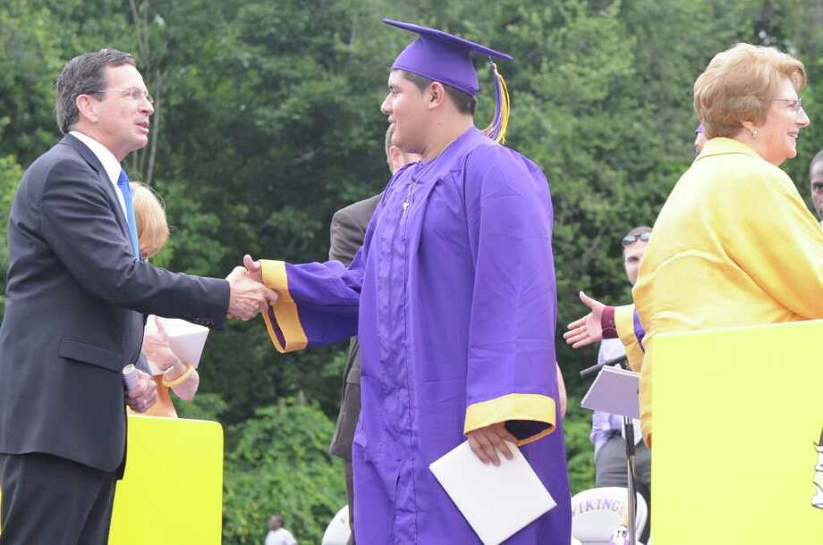 Governor Dannel P. Malloy greets graduates at his alma mater Westhill High School during the class of 2011 commencement exercises in Stamford, Conn., June 23, 2011. Photo: Keelin Daly / Stamford Advocate