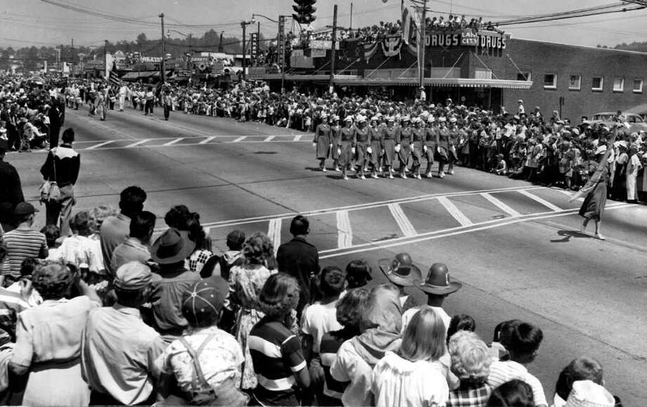 Women of the Kirkland Eagles auxiliary drill team during the 1950 Lake City Pioneer Days parade at what's now Northeast 125th Street and Lake City Way Northeast. Photo: Seattlepi.com File