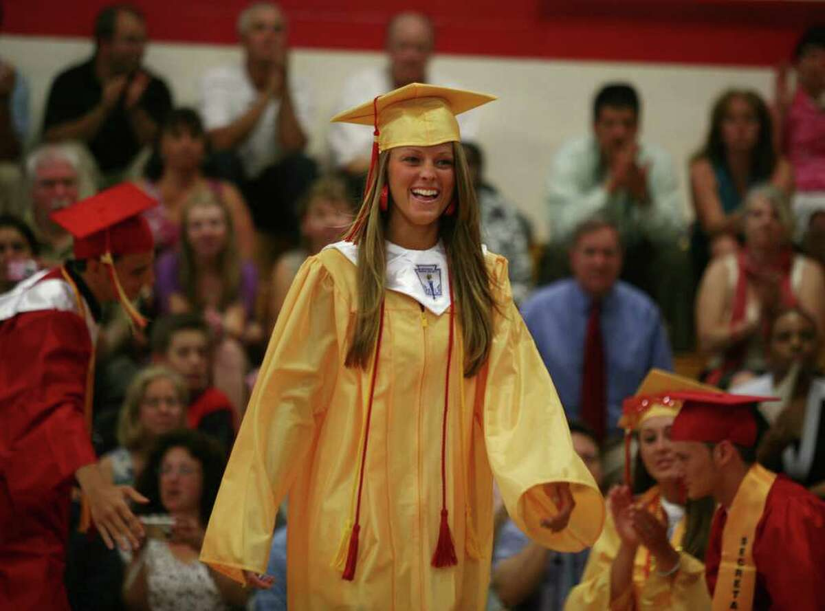 Graduate Sarah Stevens smiles as she walks up to receive her diploma at the Stratford High School graduation on Thursday, June 23, 2011.