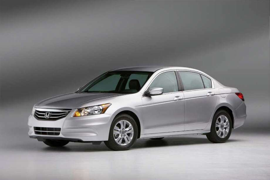 FILE - This undated file picture provided by Honda shows the 2011 Honda Accord SE Sedan. The Accord was ranked the highest midsize car in the J.D. Power and Associates 2011 U.S. Initial Quality Study. (AP Photo/Honda) Photo: Anonymous