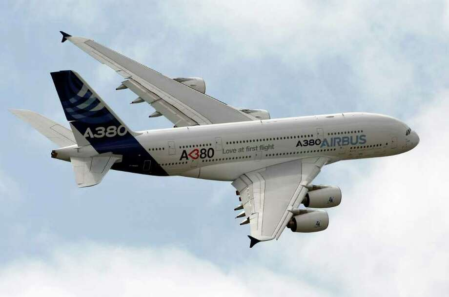 The Airbus A380 giant jetliner performs its demonstration flight during the 49th Paris Air Show, at le Bourget airport, north of Paris, Thursday June 23, 2011. (AP Photo/Remy de la Mauviniere) Photo: REMY DE LA MAUVINIERE / AP