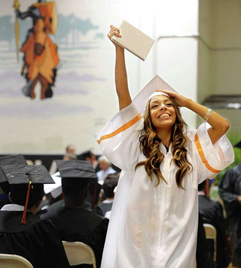 Vanessa Reyes holds up her diploma during Stamford High School's graduation ceremony Thursday, June 23, 2011. Photo: Lindsay Niegelberg / Connecticut Post