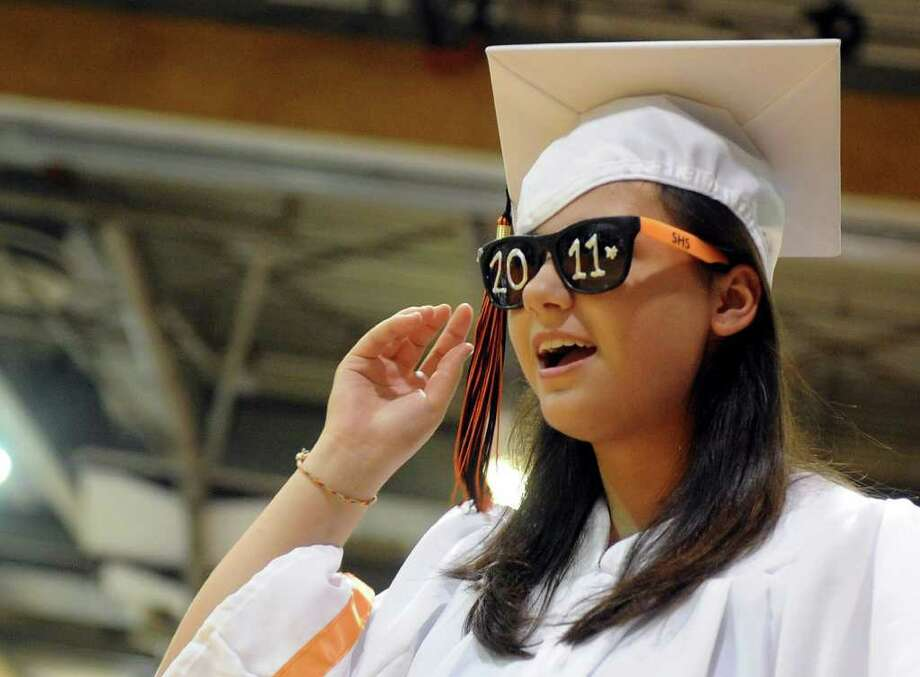 Erin Kresmery puts on her 2011 sunglasses during Stamford High School's graduation ceremony Thursday, June 23, 2011. Photo: Lindsay Niegelberg / Connecticut Post