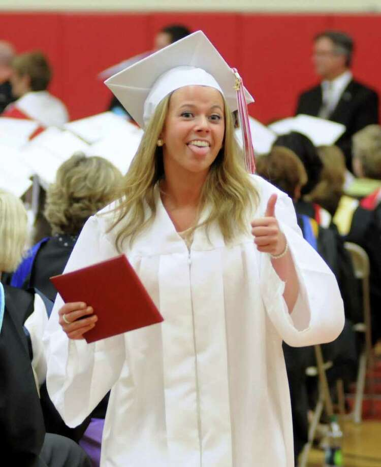 Avery Sutton gives the thumbs up after she recieved her diploma during the Masuk High School Graduation ceremony on Thursday June 23, 2011. Commencement ceremonies where held in the gymnasium due to rain. Photo: Lisa Weir / The News-Times Freelance