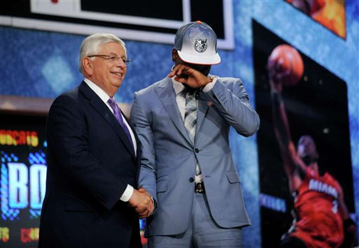 NBA Commissioner David Stern, left, poses with Connecticut's Kemba Walker, who was selected by the Charlotte Bobcats with the No. 9 pick in the NBA basketball draft Thursday, June, 23, 2011, in Newark, N.J. (AP Photo/Bill Kostroun)