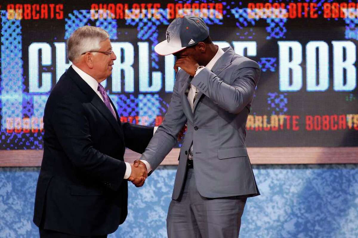 NEWARK, NJ - JUNE 23: Kemba Walker from UCONN is overcomer with emotion as he greets NBA Commissioner David Stern after he was selected #7 overall by the Charlotte Bobcats in the first round during the 2011 NBA Draft at the Prudential Center on June 23, 2011 in Newark, New Jersey. NOTE TO USER: User expressly acknowledges and agrees that, by downloading and/or using this Photograph, user is consenting to the terms and conditions of the Getty Images License Agreement. (Photo by Mike Stobe/Getty Images)