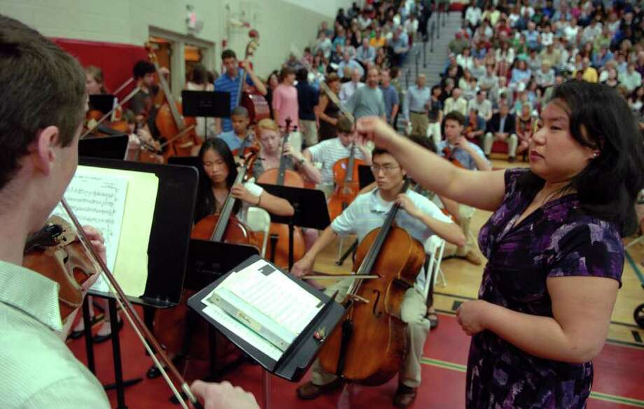 "Highlights from Fairfield Warde High School's 7th Annual Commencement Exercises in Fairfield, Conn. on Wednesday June 23, 2011. Victoria Kuan directs the orchestra during a rendition of ""Pomp and Circumstance"" by Sir Edward Elgar. Photo: Christian Abraham / Connecticut Post"
