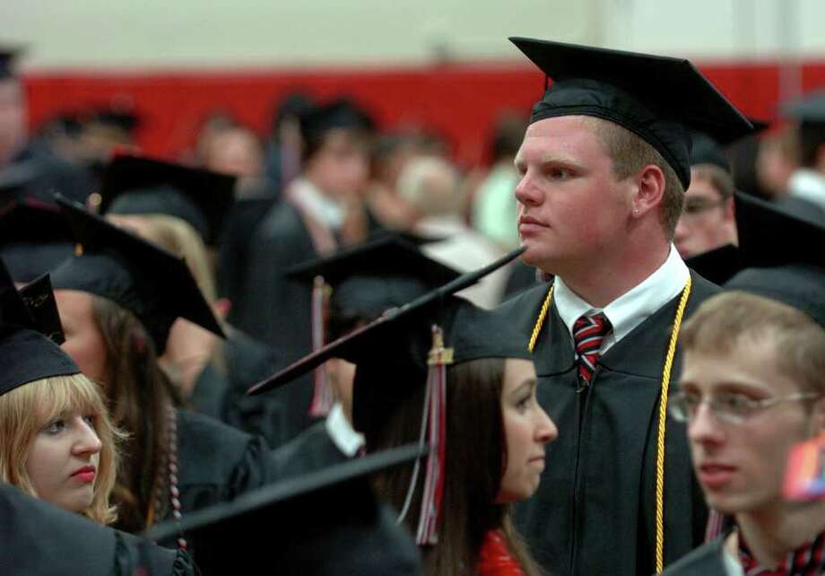 Highlights from Fairfield Warde High School's 7th Annual Commencement Exercises in Fairfield, Conn. on Wednesday June 23, 2011. Graduate Myles McQuone. Photo: Christian Abraham / Connecticut Post