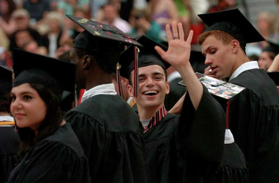Highlights from Fairfield Warde High School's 7th Annual Commencement Exercises in Fairfield, Conn. on Wednesday June 23, 2011. Graduate Julian Irizarry waves to familiy. Photo: Christian Abraham / Connecticut Post