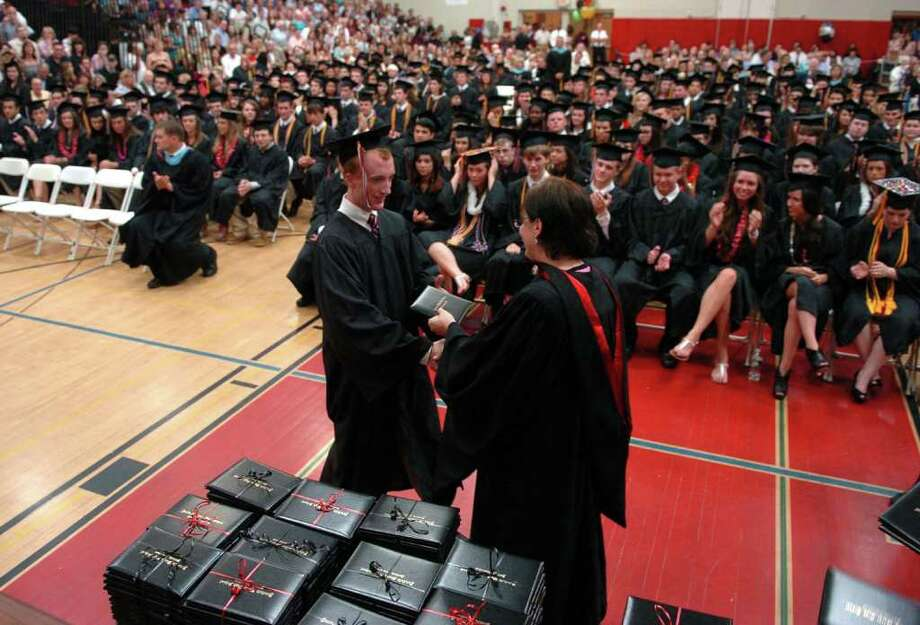 Highlights from Fairfield Warde High School's 7th Annual Commencement Exercises in Fairfield, Conn. on Wednesday June 23, 2011. Graduate Ross Anderson receives his dilpoma. Photo: Christian Abraham / Connecticut Post