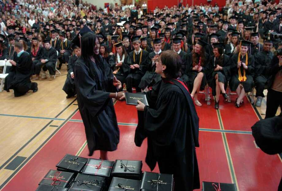 Highlights from Fairfield Warde High School's 7th Annual Commencement Exercises in Fairfield, Conn. on Wednesday June 23, 2011. Grqaduate Kara Anglin receives her diploma. Photo: Christian Abraham / Connecticut Post