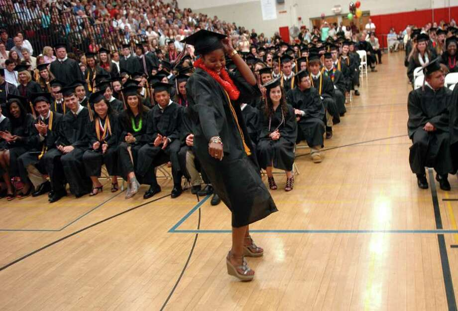 Highlights from Fairfield Warde High School's 7th Annual Commencement Exercises in Fairfield, Conn. on Wednesday June 23, 2011. Graduate Britney St. Pierre does a little dance as she goes up for her diploma. Photo: Christian Abraham / Connecticut Post
