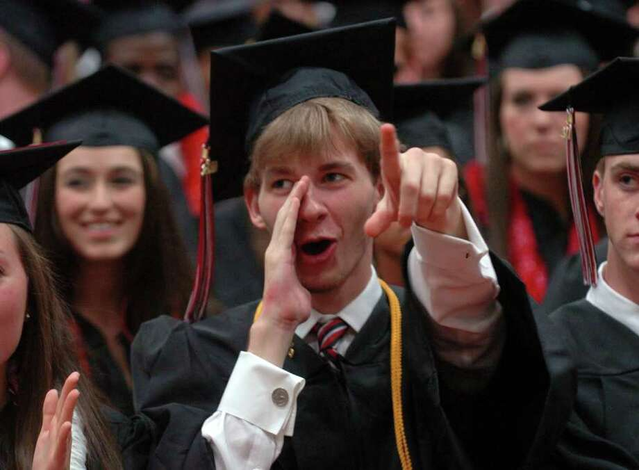 Highlights from Fairfield Warde High School's 7th Annual Commencement Exercises in Fairfield, Conn. on Wednesday June 23, 2011. Chip Foarde cheers for his friends as they get their diplomas. Photo: Christian Abraham / Connecticut Post