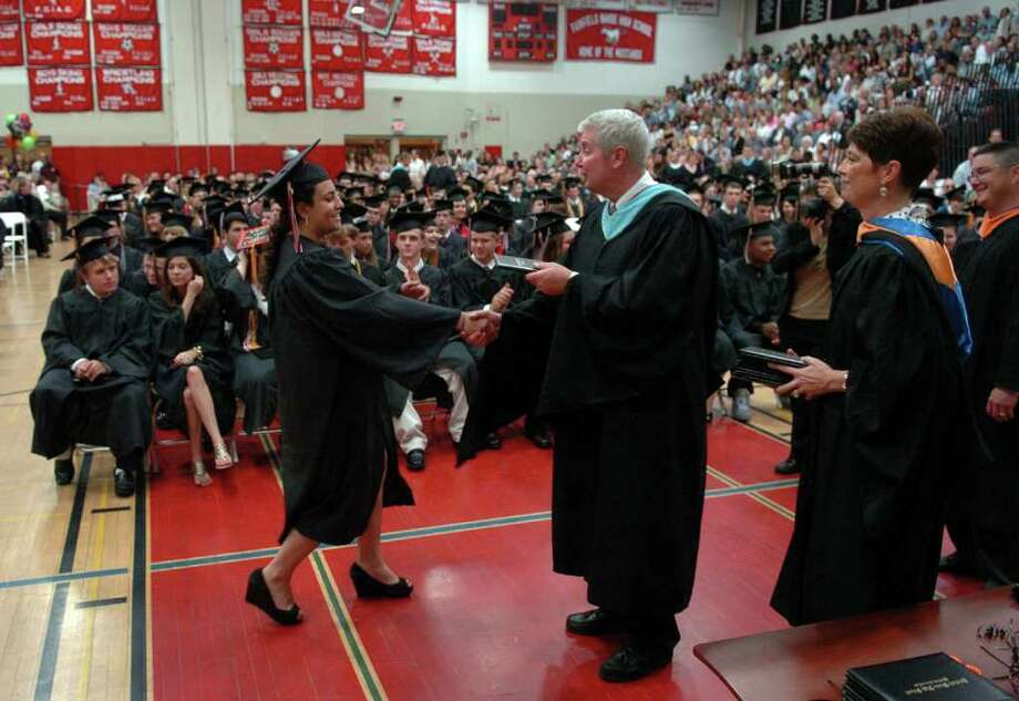 Highlights from Fairfield Warde High School's 7th Annual Commencement Exercises in Fairfield, Conn. on Wednesday June 23, 2011. Graduate Eliana Mizrahi receives her diploma. Mizrahi will be volunteering for the Israeli Defense Forces. Photo: Christian Abraham / Connecticut Post