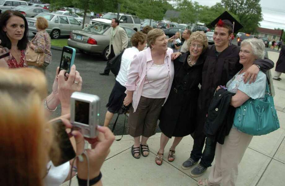 Highlights from Fairfield Warde High School's 7th Annual Commencement Exercises in Fairfield, Conn. on Wednesday June 23, 2011. Graduate Michael Sullivan poses for family photos with three of his grandmaothers. From left to right his his grandmothers Janet Sullivan, Ferne Kleban, and at right, Sharon Cloutier. Photo: Christian Abraham / Connecticut Post