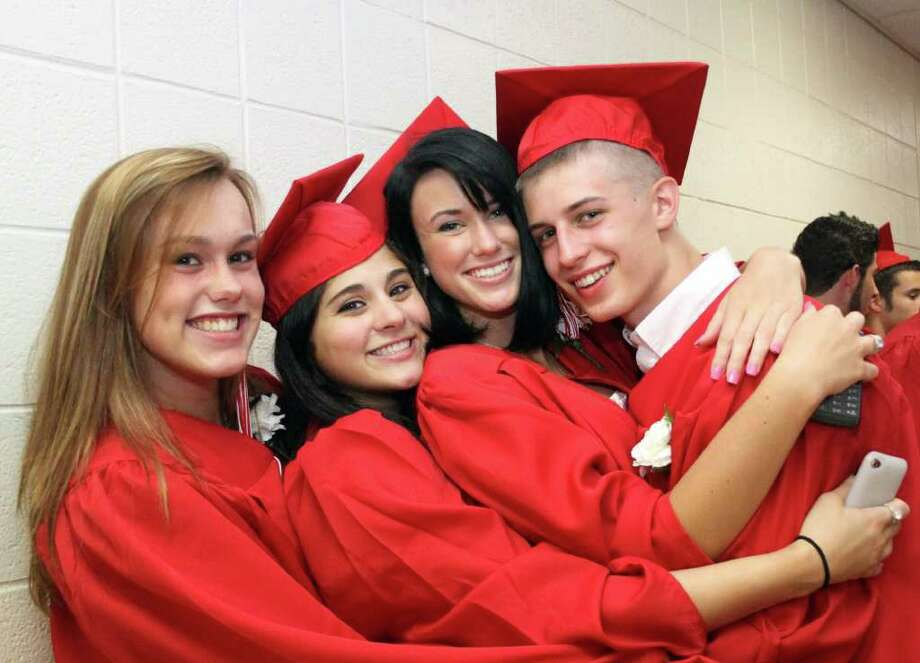 Good friends Shelby Foster, Keary Barnett, Liz King and Marc Barna enjoy each others company prior to the Pomperaug High School's graduation exercises held Thursday evening. Photo taken 06/23/11 Photo: Walter Kidd / The News-Times Freelance