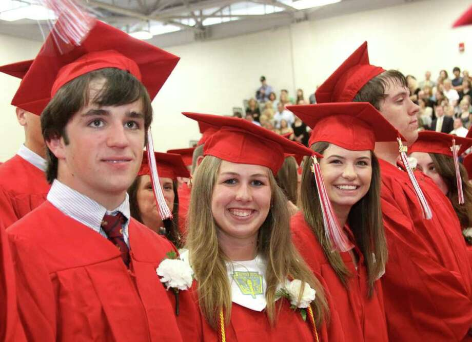 Tyler Gabrielson, Alyssa Fuso and Cassondra Funk participate in the Pomperaug High School's graduation exercises held Thursday evening. Photo taken 06/23/11 Photo: Walter Kidd / The News-Times Freelance