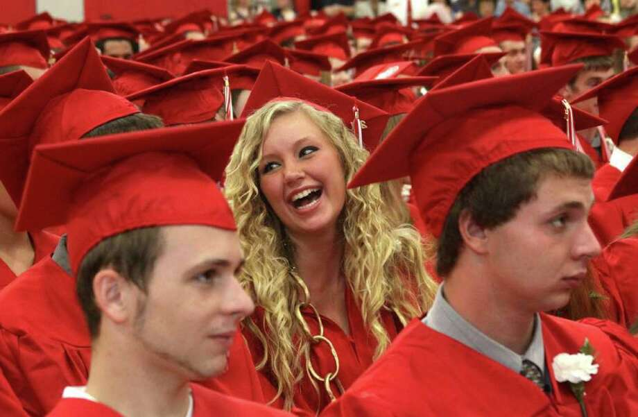 Hannah Colt is all smiles during the Pomperaug High School's graduation exercises held Thursday evening. Photo: Walter Kidd / The News-Times Freelance