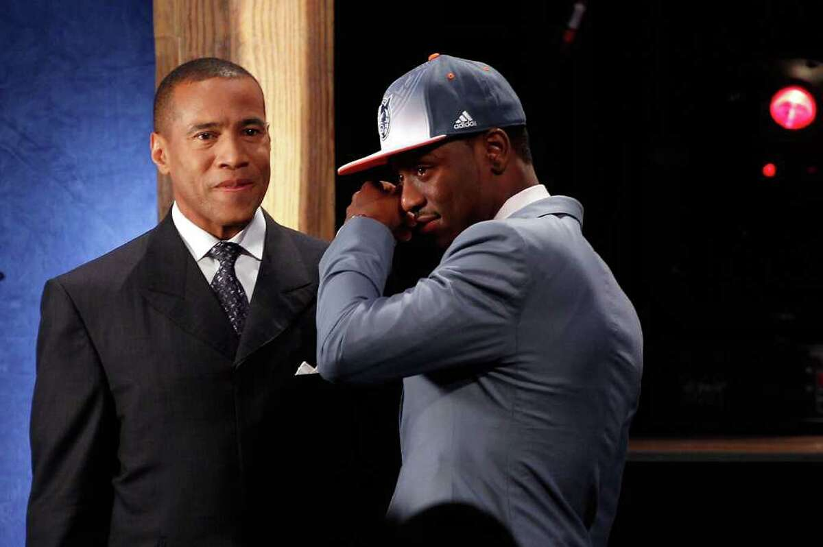 NEWARK, NJ - JUNE 23: Kemba Walker from UCONN is overcome with emotion while he is interviewed by Mark Jones after he was selected #9 overall by the Charlotte Bobcats in the first round during the 2011 NBA Draft at the Prudential Center on June 23, 2011 in Newark, New Jersey. NOTE TO USER: User expressly acknowledges and agrees that, by downloading and/or using this Photograph, user is consenting to the terms and conditions of the Getty Images License Agreement. (Photo by Mike Stobe/Getty Images)