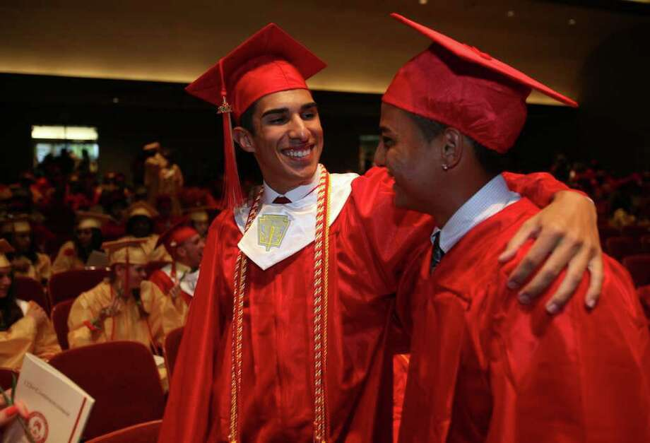 Nicholas Prieto, left, and Christian Arias at Stratford High School graduation on Thursday, June 23, 2011. Photo: Brian A. Pounds / Connecticut Post