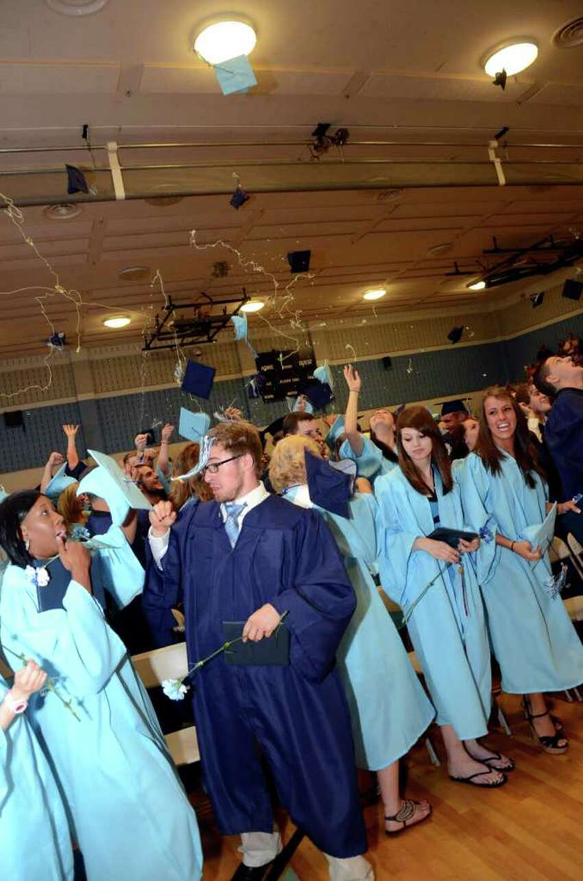 Silly string and hats fly during the Oxford High School Class of 2011 commencement on Thursday, June 23, 2011.