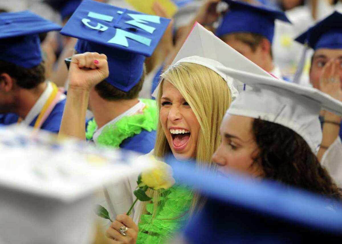 Graduate Maddie Love cheers for the class of 2011 as Fairfield Ludlowe High School holds its commencement ceremony Thursday, June 23, 2011 at the school.