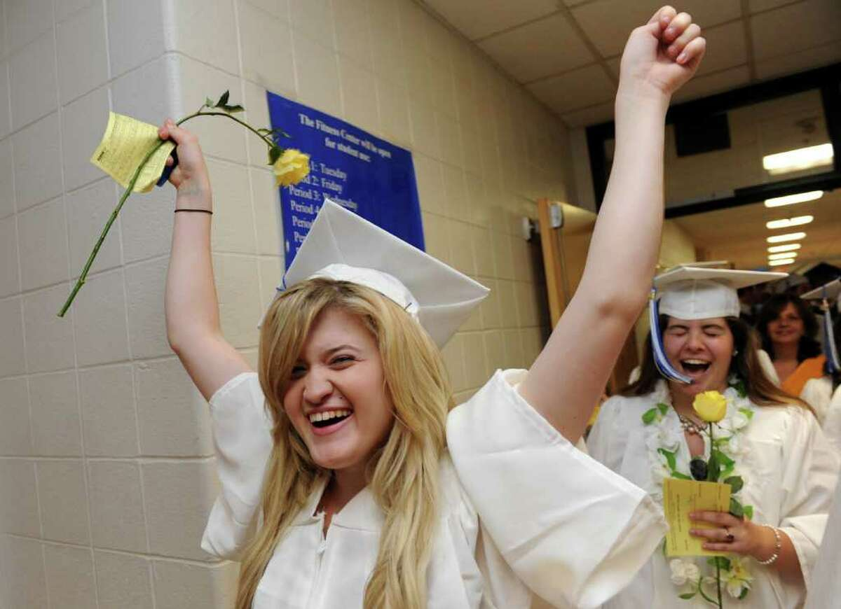 Graduate Jill Ference cheers as the class of 2011 marches into the auditorium for Fairfield Ludlowe High School's commencement ceremony Thursday, June 23, 2011.