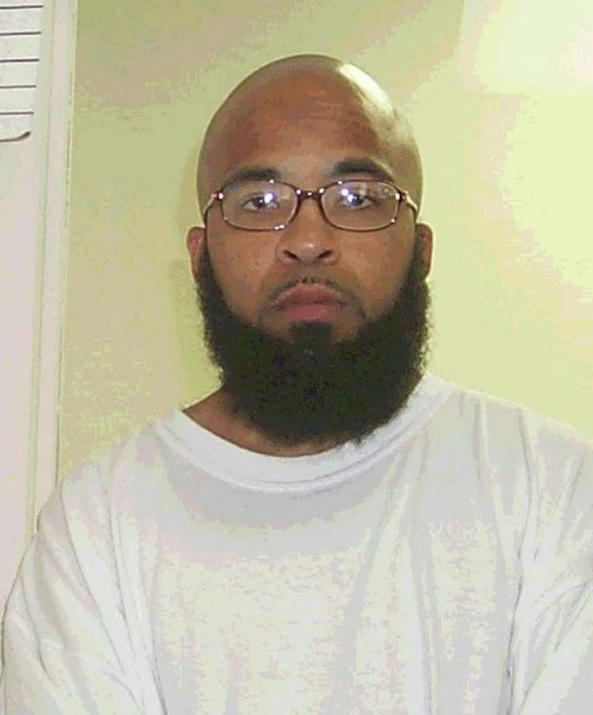 This is a 2004 photo provided by the Washington State Department of Corrections showing Abu Khalid Abdul-Latif, also known as Joseph Anthony Davis, of Seattle. Davis, and Walli Mujahidh, also known as Frederick Domingue Jr., of Los Angeles, were arrested Wednesday night, June 22, 2011. They men were arrested at a warehouse garage when they arrived to pick up machine guns to use in an alleged terror plot.