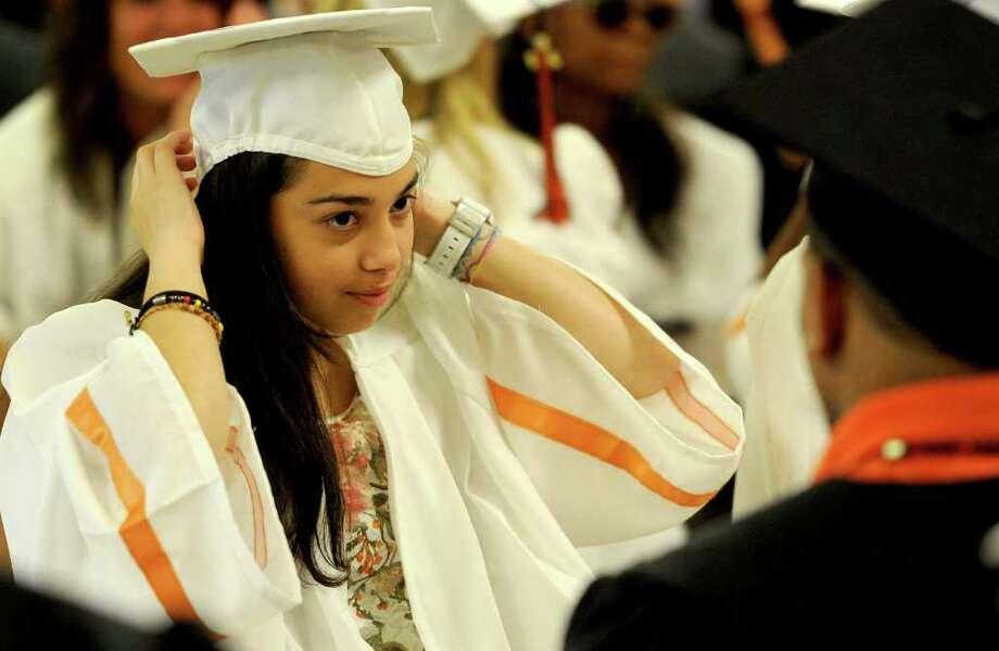 Karen Ventura adjusts her cap before Stamford High School's graduation ceremony on Thursday, June 23, 2011. Photo: Lindsay Niegelberg / Connecticut Post