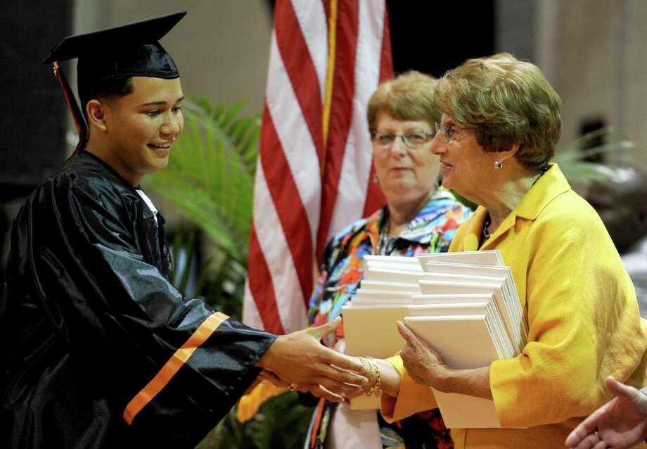 Kevin Santiago-Orellana gets his diploma during Stamford High School's graduation ceremony on Thursday, June 23, 2011. Photo: Lindsay Niegelberg / Connecticut Post
