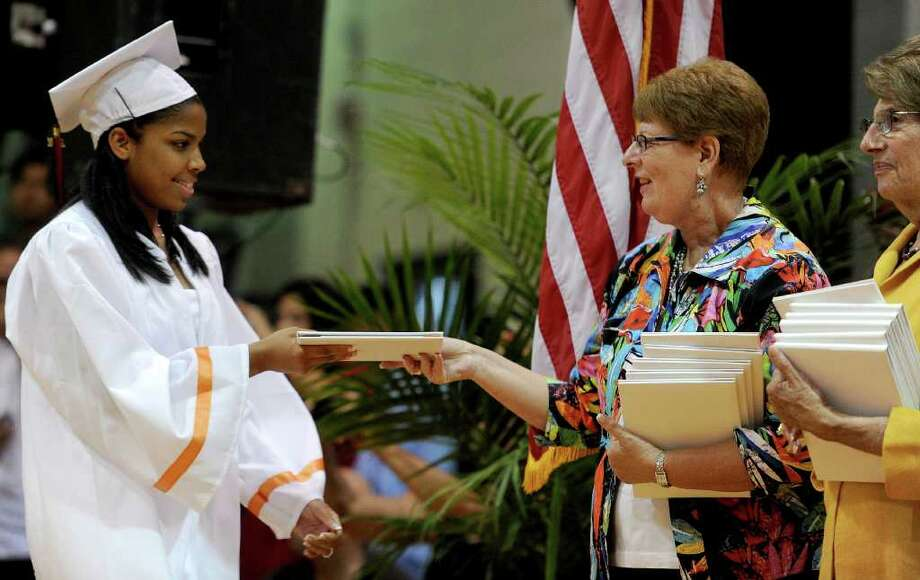 Roseangel Ozuna-Diaz gets her diploma during Stamford High School's graduation ceremony on Thursday, June 23, 2011. Photo: Lindsay Niegelberg / Connecticut Post