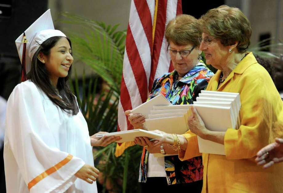 Susana Escobar gets her diploma during Stamford High School's graduation ceremony on Thursday, June 23, 2011. Photo: Lindsay Niegelberg / Connecticut Post