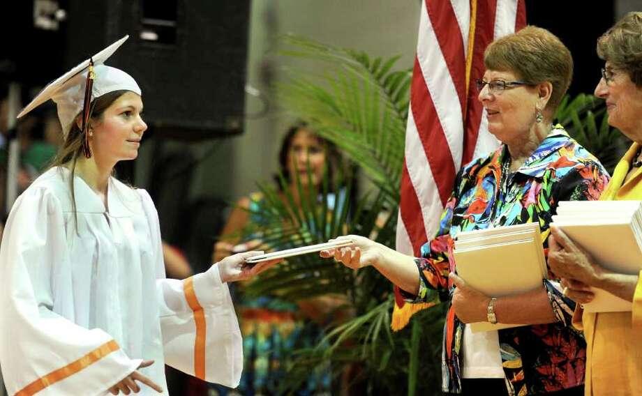 Katherine Ledermann gets her diploma during Stamford High School's graduation ceremony on Thursday, June 23, 2011. Photo: Lindsay Niegelberg / Connecticut Post
