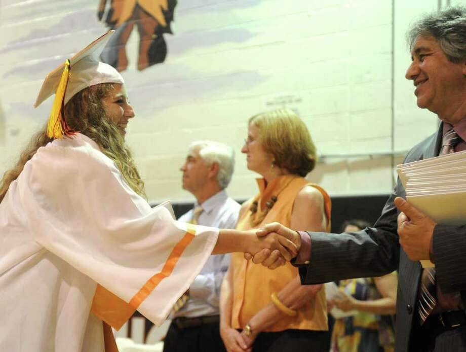 Zoe Shwidock gets her diploma during Stamford High School's graduation ceremony on Thursday, June 23, 2011. Photo: Lindsay Niegelberg / Connecticut Post