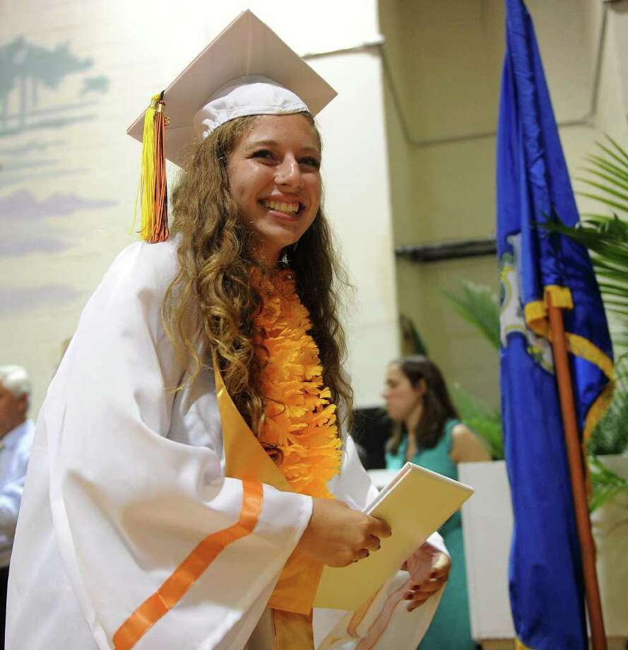 Zoe Shwidock smiles after getting her diploma during Stamford High School's graduation ceremony on Thursday, June 23, 2011. Photo: Lindsay Niegelberg / Connecticut Post