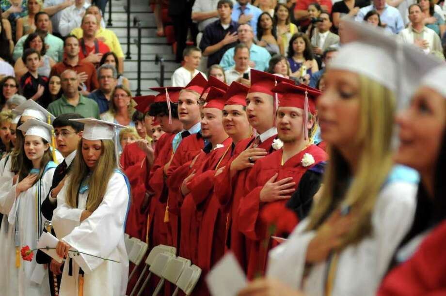 Students and their families say the Pledge of Allegiance. Masuk High School helds it's Graduation ceremony on Thursday June 23, 2011. Commencement ceremonies where held in the gymnasium due to rain. Photo: Lisa Weir / The News-Times Freelance