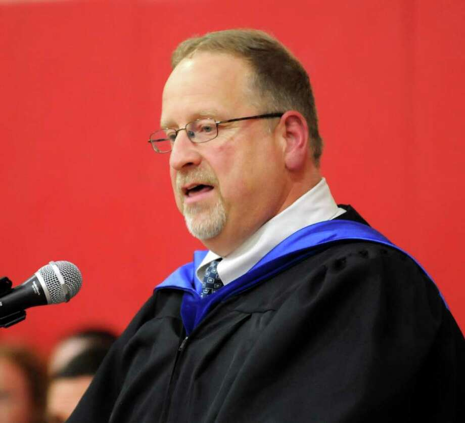 John Battista the school principal addresses the students during  Masuk High School helds it's Graduation ceremony on Thursday June 23, 2011. Commencement ceremonies where held in the gymnasium due to rain. Photo: Lisa Weir / The News-Times Freelance